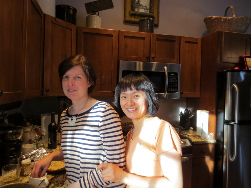 Writer Michelle Aldredge and Composer Eun Young Lee prepare a Korean meal at Brush Creek Foundation for the Arts, a residency in Saratoga, Wyoming (Photo by Anne Connell)