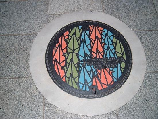 http://www.gwarlingo.com/wp-content/uploads/2011/08/Paper-Crane-Design-in-Hiroshima-Manhole-Cover.jpg