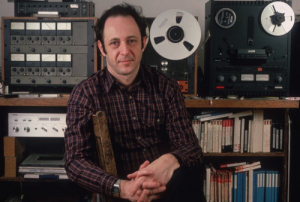 Composer Steve Reich with reel to reel tape recorders