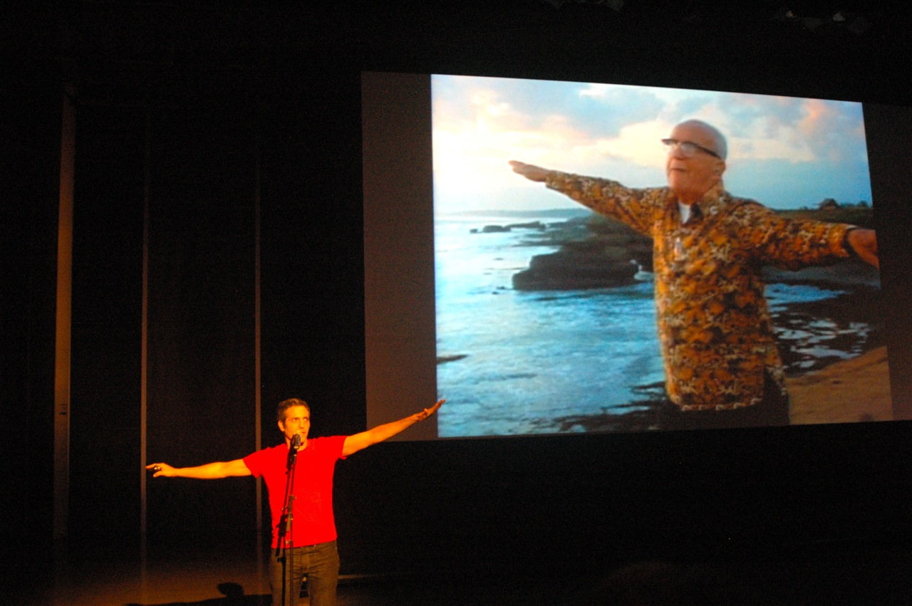 Sam Green narrating his live documentary The Love Song of R. Buckminster Fuller at the Institute of Contemporary Art in Boston (Photo by Michelle Aldredge)
