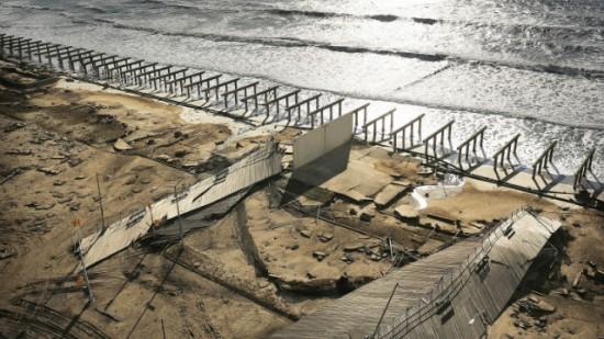 The wreckage of Rockaway Boardwalk, after Sandy (Image via CNN.com)