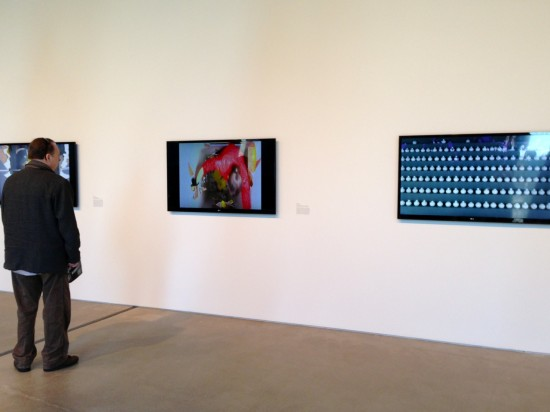 A museum visitor at MOCA Cleveland takes in the Kate Gilmore exhibit, Body of Work (Photo by Michelle Aldredge)