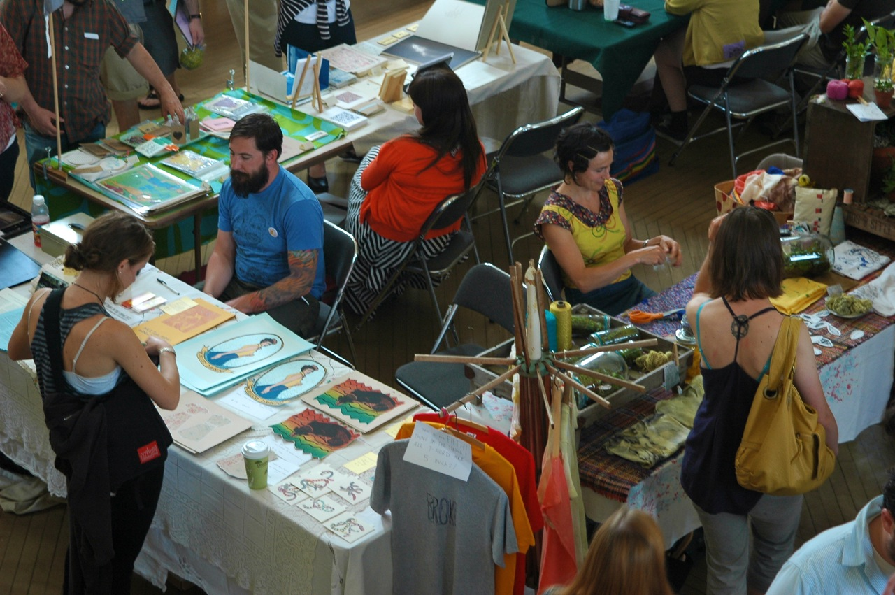 Festival organizer and musician Eric Gagne (left) and artist Emily Drury (right) at the 2012 *broke art fair (Photo by Michelle Aldredge, 2012)