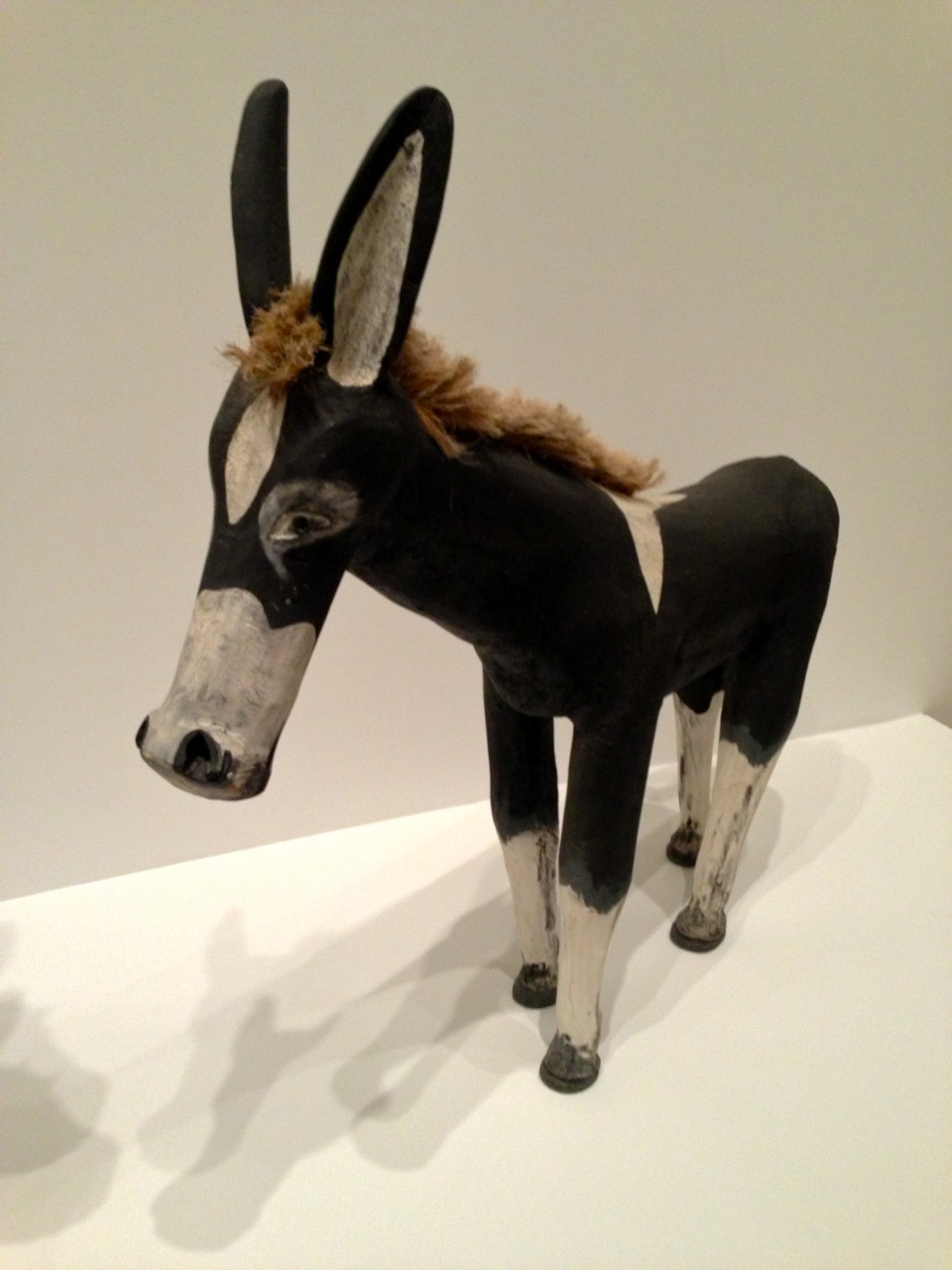 Filipe Benito Archuleta, Donkey, 1981. Cottonwood, paint, glass marbles, sisal, sawdust, glue 49 1/2 x 51 x 10 1/2 inches (Photo by Michelle Aldredge from The Jill and Sheldon Bonovitz Collection at the Philadelphia Museum of Art)