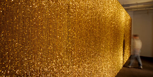Felix Gonzalez-Torres, Untitled (Golden), 1995. Plastic beads and metal rod, variable dimensions. (Photo by Thorsten Monschein © The Felix Gonzalez-Torres Foundation Courtesy Andrea Rosen Gallery, New York and The Solomon R. Guggenheim Museum)