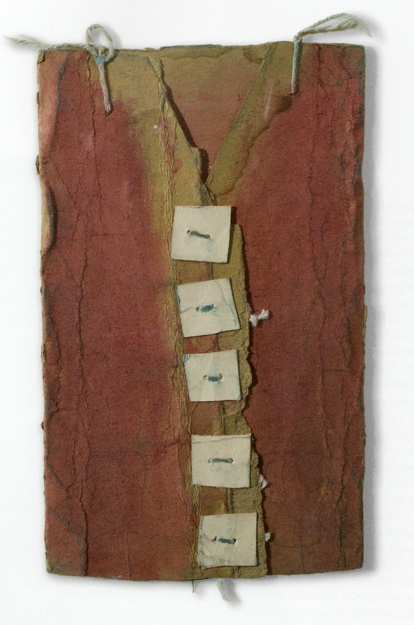 James Castle, Red Vest with White Buttons. Tan/brown cardboard and cream card; punched, stitched and tied with white cotton string; red water-based paint, 9 1/2 x 6 inches. (Photo by Will Brown courtesy the Philadelphia Museum of Art, The Jill and Sheldon Bonovitz Collection)