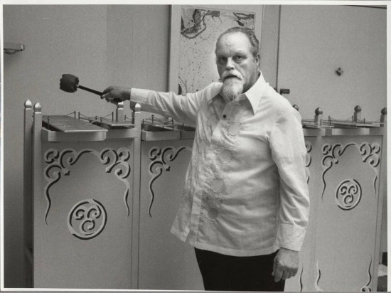 Lou Harrison in 1983 with a metallophone during a musical session at the home of Betty Freeman  (Photo by Betty Freeman Courtesy of Los Angeles Philharmonic Archives)