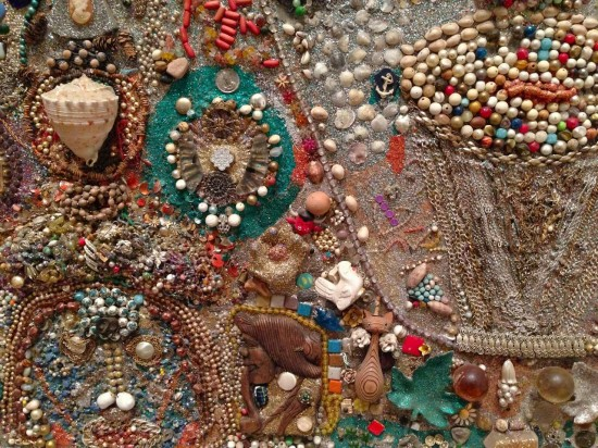 Simon Sparrow, Assemblage with Faces, detail. Glitter, paint, molded plastic figurines (Star Wars figures, putti, and devils), shells, vessels, frames, jewelry, buttons, beads, seeds, glass, stone, paster, pine cones, and other found objects on wood; artist-made painted wood frame, 56 1/2 x 107 x 3 1/2 inches with frame. (Photo by Michelle Aldredge from   The Jill and Sheldon Bonovitz Collection at the Philadelphia Museum of Art)