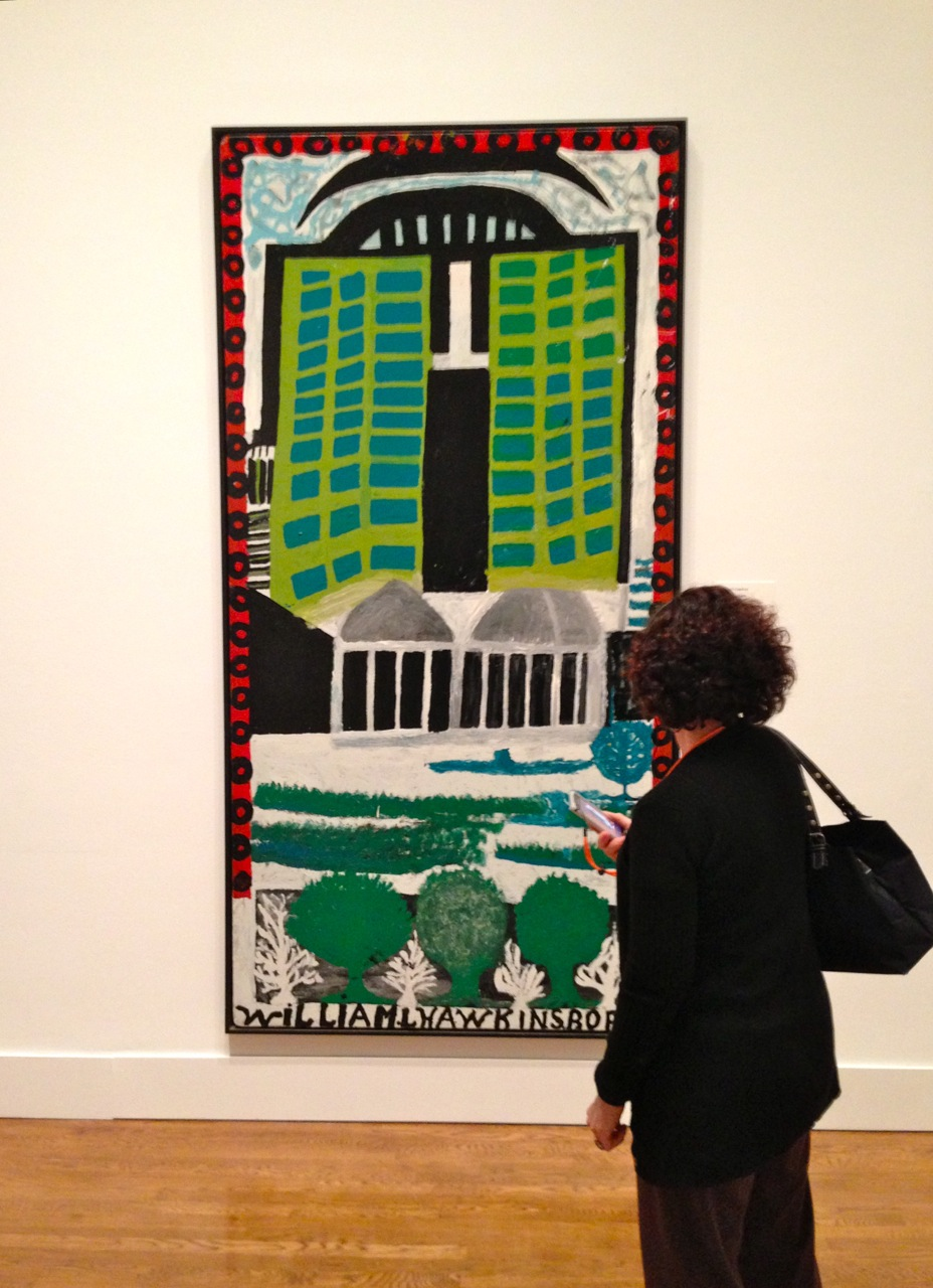 A visitor at the Philadelphia Museum of Art examines William Hawkins' Green Towers, made of alkyd house paint on Masonite. (Photo by Michelle Aldredge from The Jill and Sheldon Bonovitz Collection at the Philadelphia Museum of Art)