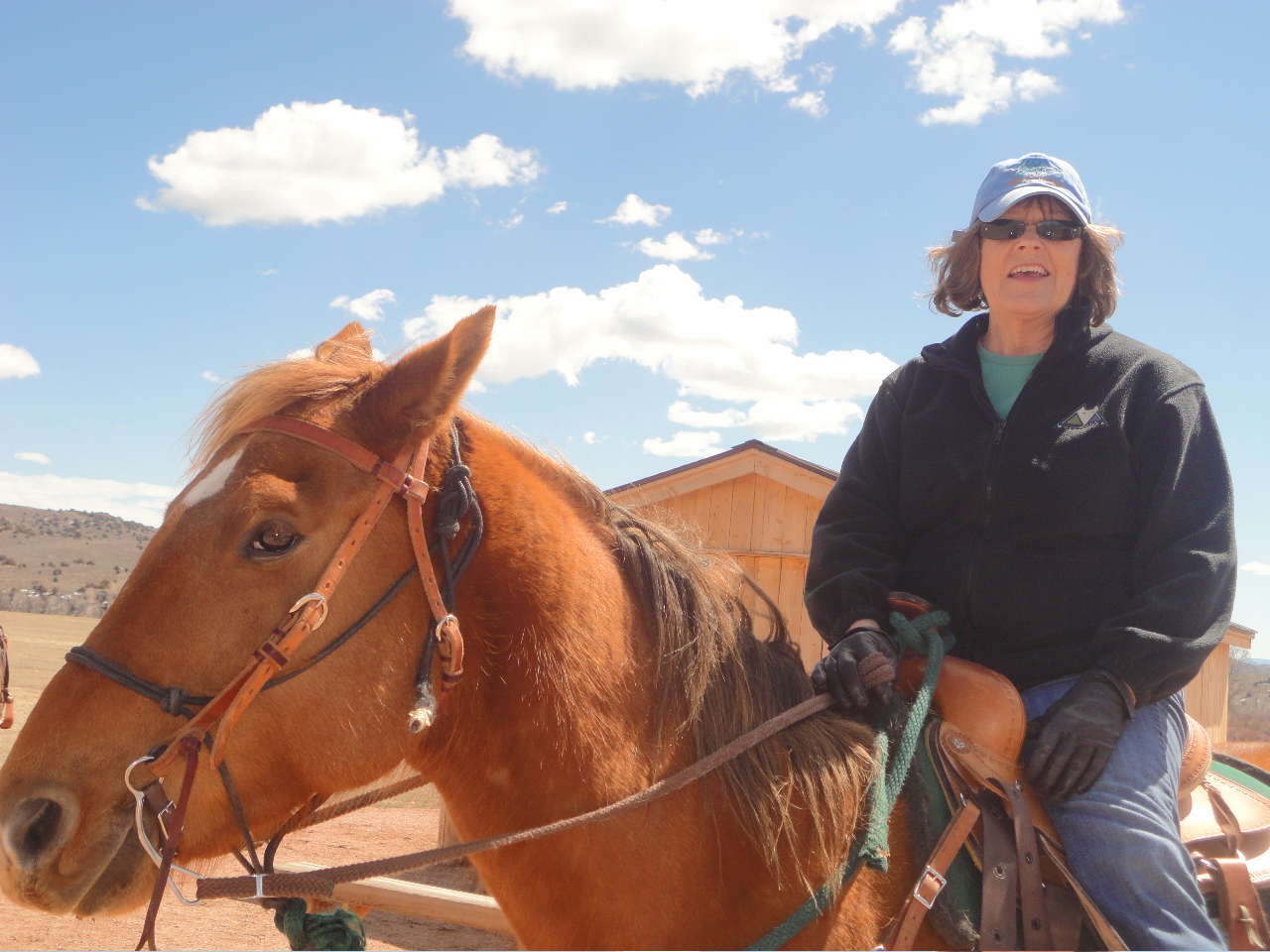 Writer Kate Kingston riding horses at Brush Creek Foundation for the Arts in Wyoming (Photo courtesy the author)