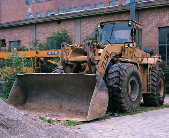 Liu Bolin, Hiding in the City No. 71 — Bulldozer, 2008. (Photo courtesy of Eli Klein Fine Art, New York © Liu Bolin)