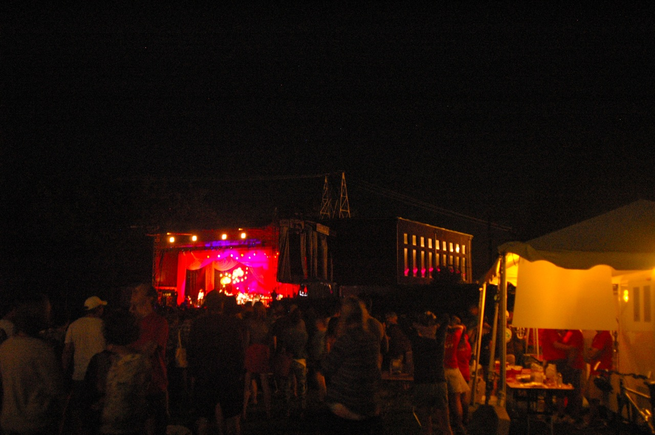 A view of the stage, crowd, and vendors at Joe's Field (Photo by Michelle Aldredge)