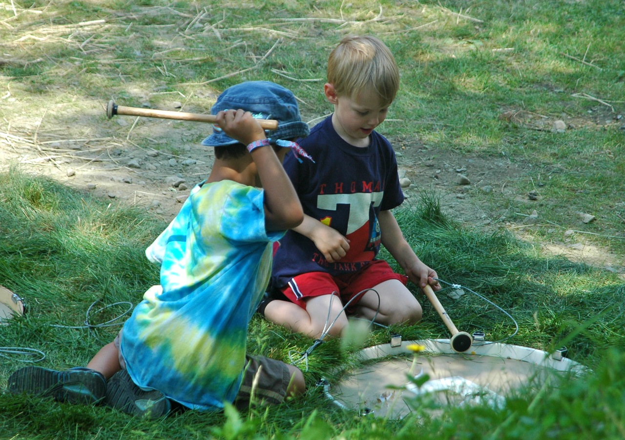 Two children play with Wilco drummer Glenn Kotche's installation Earth Drums, which encouraged kids to try morse code. (Photo by Michelle Aldredge)