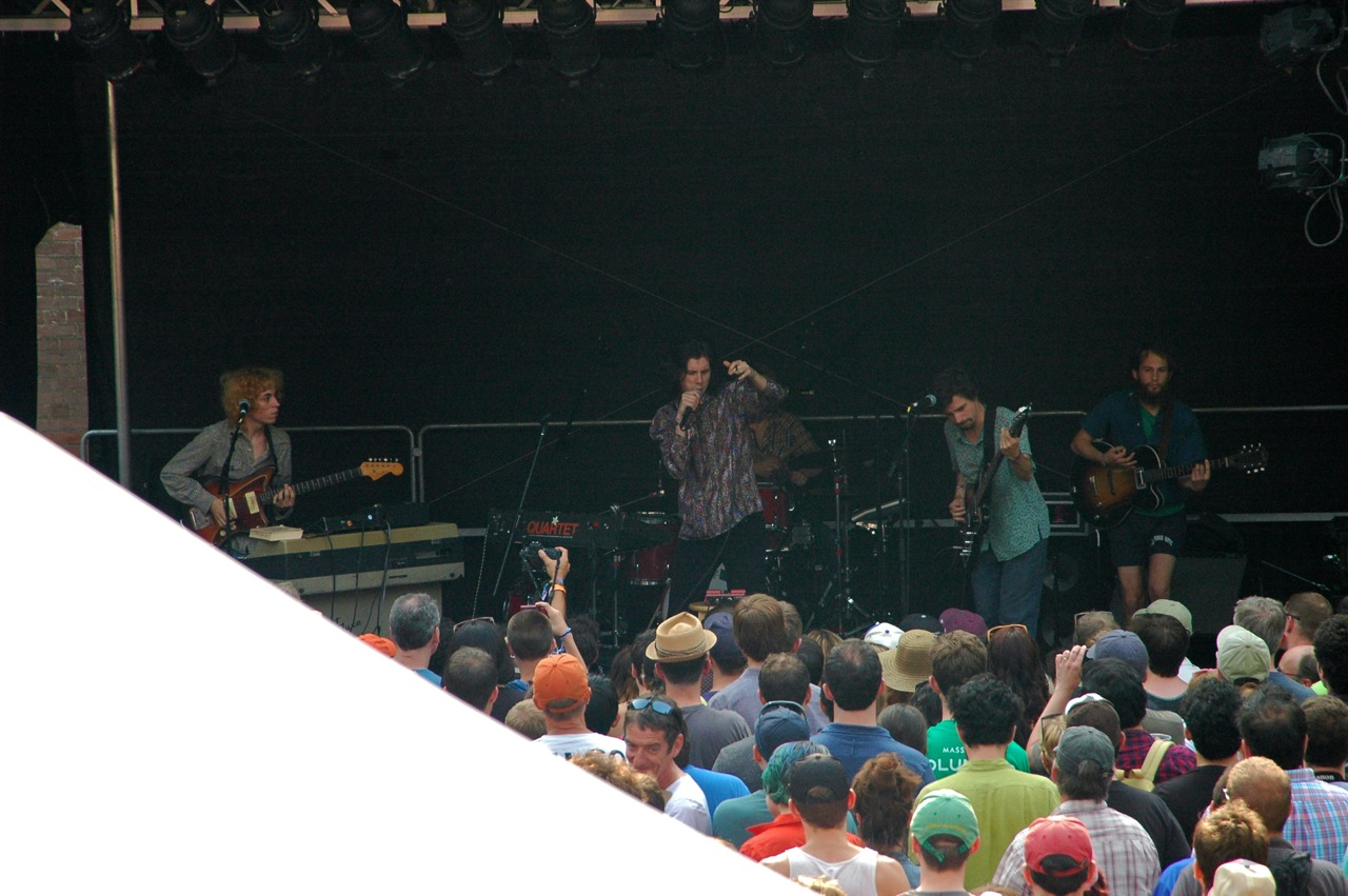 "Foxygen's lead singer Sam France won over the crowd with his boundless energy and Mick Jagger moves. France was halfway up a metal stage support before crewmember rushed onstage and pulled him down. The band kept playing through the incident. Afterward France declared, ""It's all part of the show. It's theater."""