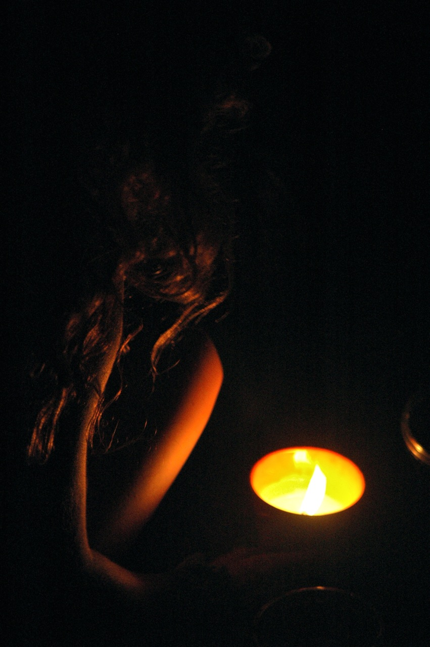A festival-goer enjoys Wilco by candlelight. (Photo by Michelle Aldredge)