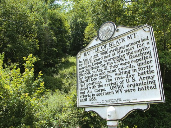 This historical marker along W.Va. 17 in Blair is the only visible sign of the 1921 battle here between thousands of armed, unionizing coal miners and the thousands of law enforcement officers and security guards hired to defeat them. At least 16 men died on the mountain, which could be turned into a strip mine. (Photo courtesy the Register-Herald)