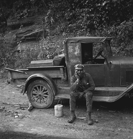 Miners paid the owner of this truck 25 cents each for a ride home. There are dollar signs on the windows, perhaps to advertise the service. (Photo by Marion Post Wolcott, 1938. Courtesy the Library of Congress)