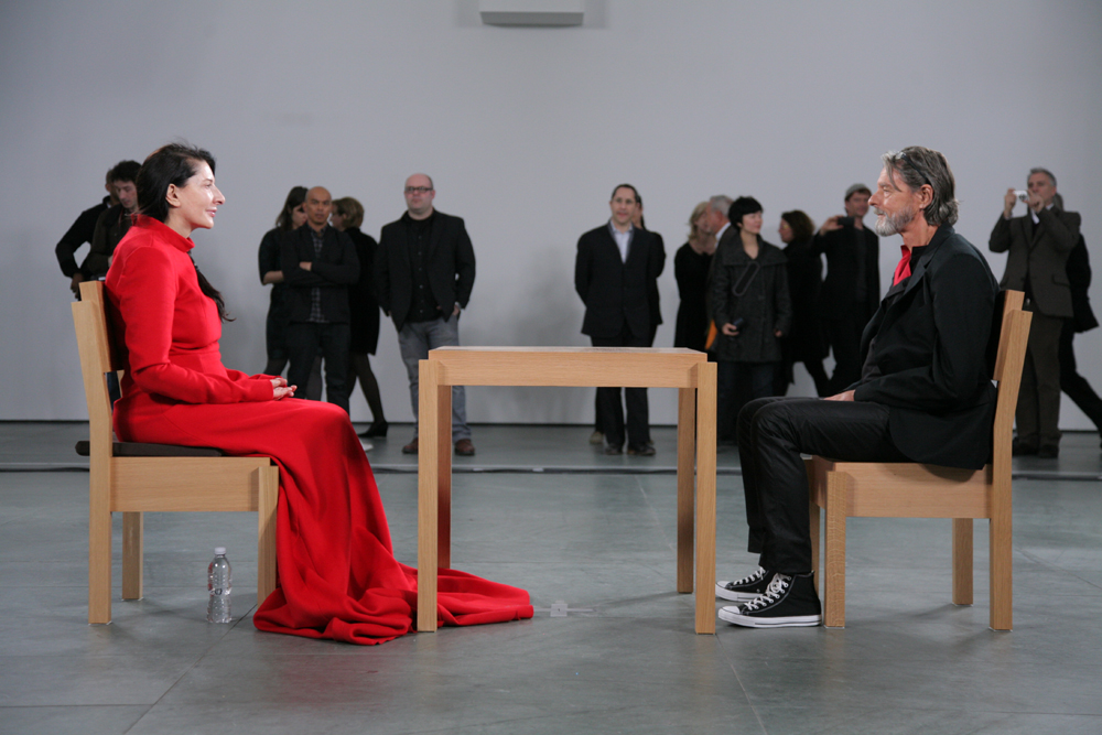 Currey describes the extreme regiment she underwent for The Artist is Present at MoMA, a performance piece that required her to sit motionless and silent in a chair six days a week for eleven weeks total (736 hours and 30 minutes in all). Abramovic trained her body to go all day without food and without urinating. This photo by Scott Rudd shows Abramovic's emotional reunion with her former partner Ulay. (Photo © 2010 Scott Rudd courtesy scottruddphotography.com)