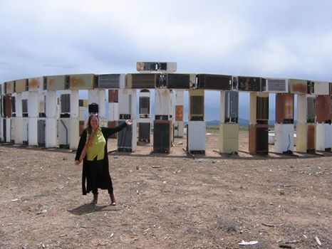 Miriam Sagan at Fridgehenge at the Santa Fe dump (Photo by Hope Atterbury)
