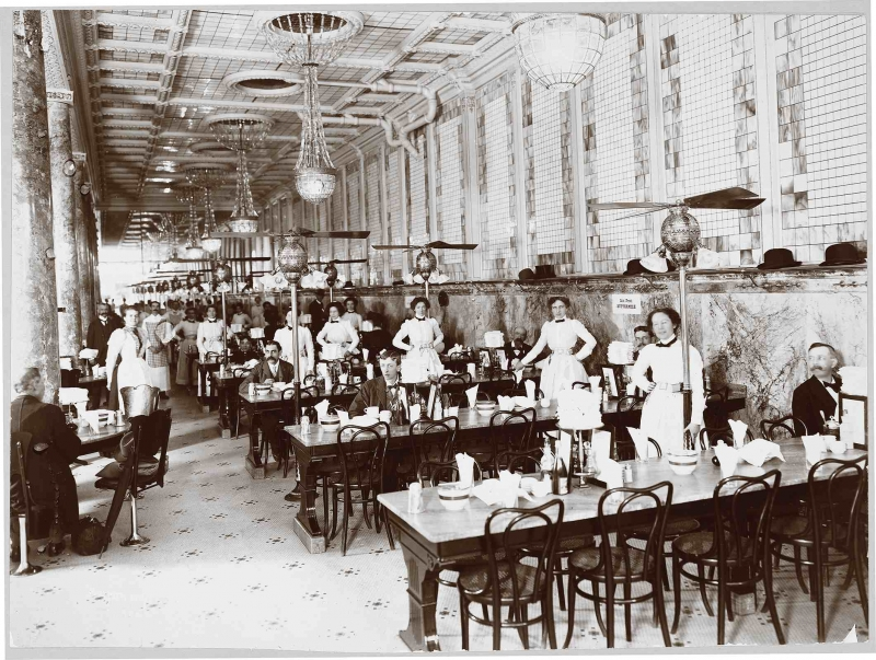 The interior of Childs Restaurant in 1900. Big windows, marble and white tile floors and walls, and waitresses whose uniforms fused the dress codes of maids with those of nurses, sent reassuring messages to hungry office workers, male and female. (Photo courtesy the Museum of the City of New York, the Byron Company Collection. Click to Enlarge)