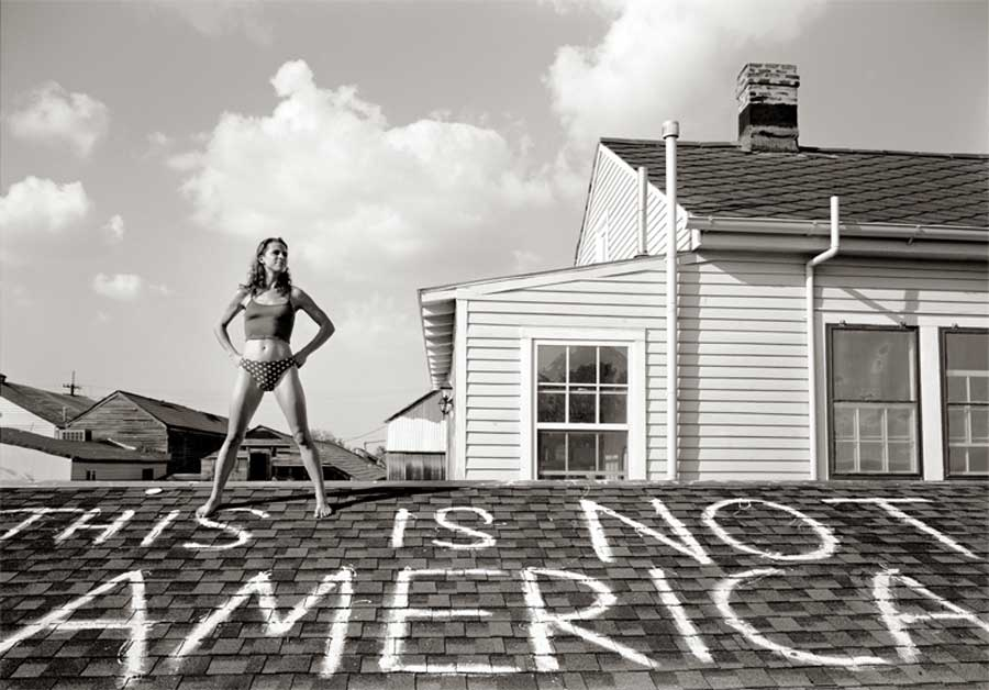 Photographer Thomas Neff took this photo of Caroline Koch on Mandeville Street after Hurricane Katrina. (Photo by Thomas Neff courtesy Lumiere Fine Art Photography Gallery)