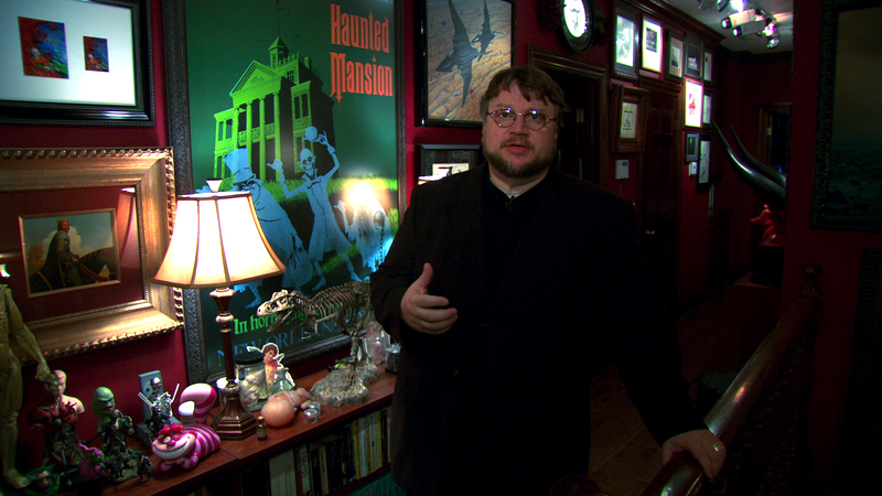 Guillermo del Toro giving a tour of the house that holds all of his memorabilia, drawings, monsters, posters, and ephemera (Video still courtesy Criterion)