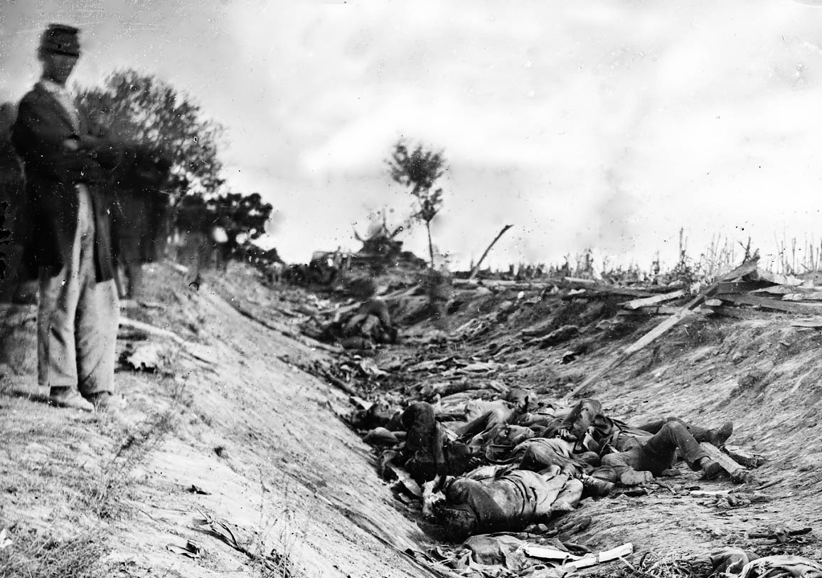 """The """"Bloody Lane"""" at Antietam, a sunken road that became so crowded with dead bodies that the Union had to stop their advance. That, and they were actually slipping in pools of blood at the base of the road. (Photo by Mathew Brady, 1862)"""