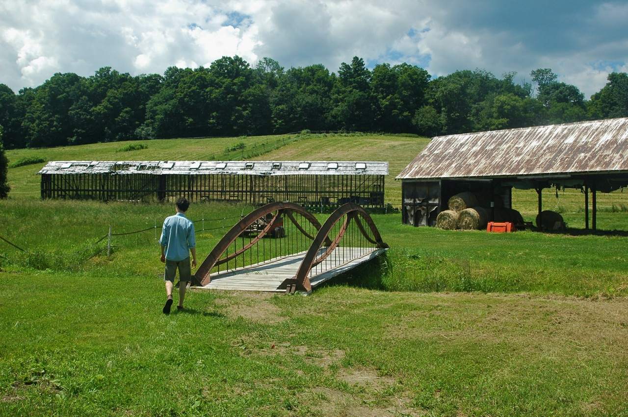 """A """"Moseley"""" wrought iron bridge from 1854 - 1 of 2 surviving in the world leads to the corncrib on the McCollough's farm. After spending over 50 years in the town dump, it now crosses the small brook to the east of the crib."""