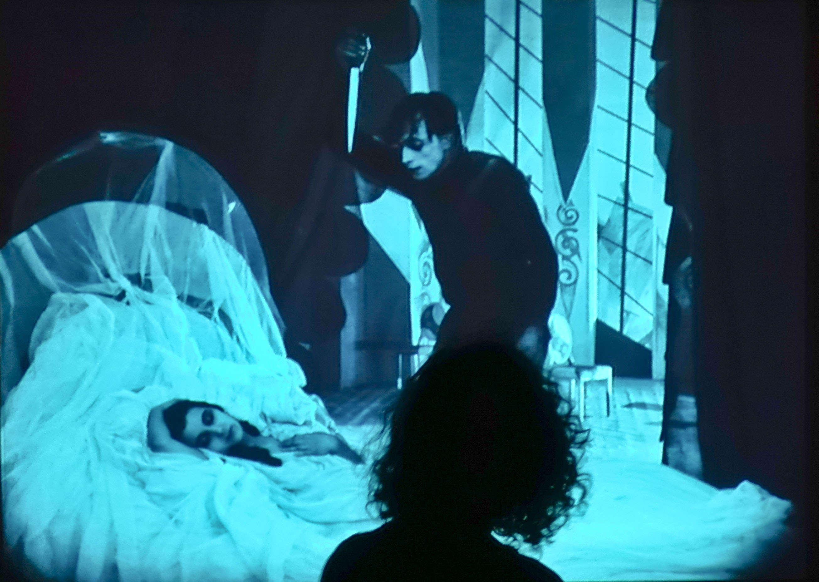 Poet, singer, and performer Ingrid Chavez dancing with The Cabinet of Dr. Caligari, newly re-scored by Paul D. Miller (Photo by Michelle Aldredge)
